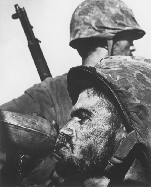 "Photographer W. Eugene Smith's picture of a Marine drinking from his canteen during 1944's Battle of Saipan is as iconic a war picture as any ever made. In fact, when the U.S. Postal Service released a ""Masters of American Photography"" series of commemorative stamps in 2002, Smith was included — and this image was chosen as representative of his body of work. See more photos here."