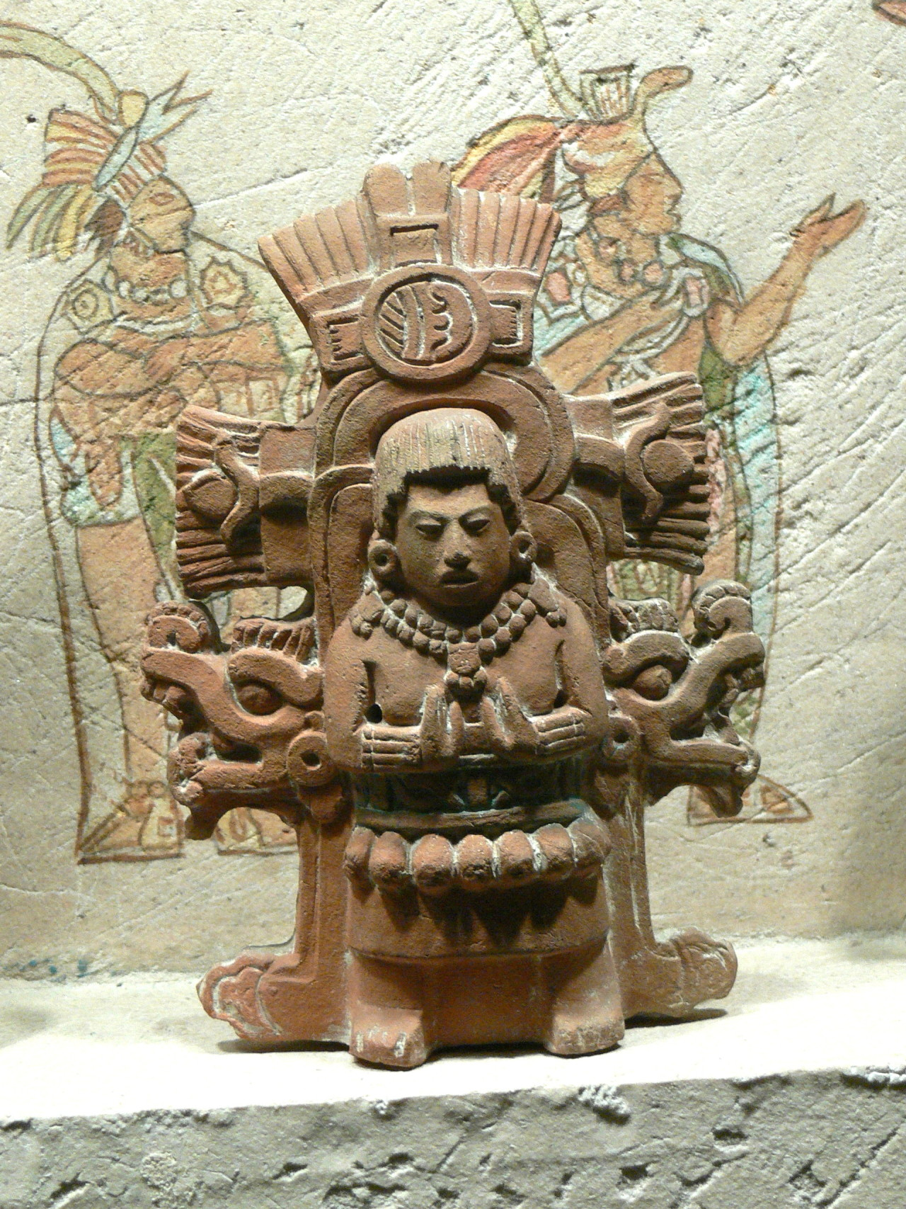 Figure of a Mayan priest. Courtesy & currently located at the National Museum of Anthropology in Mexico City. Photo taken by Wolfgang Sauber
