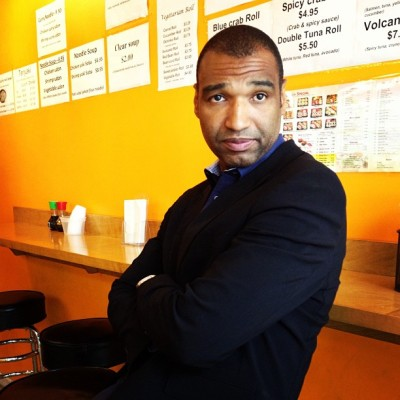 Stranger in the Sushi Store #male #suit #seat  #sitting  #menu #stare #yellow wall