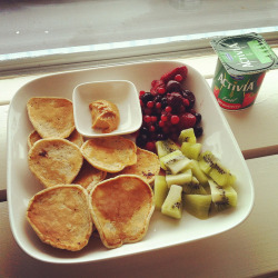 healthyisalwaysbetter:  Breakfast Healthy pancakes with berries, kiwi, natural peanut butter, strawberry activia yogurt and 2 big cups of coffee. The last 2 times making pancakes, I didn't measure anything. At least, I measured it with tablespoons, but I didn't weigh the flour or almond milk so I don't know how many grams/calories I used. But I don't care, luckily they're healthy :)!