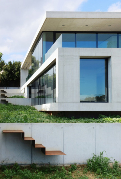 "designed-for-life:  House in Costa d'en Blanes by SCT Estudio de Arquitectura  ""Our aim was to make the volumetry of the building simple, clear and emphatic. In this regard, the side façades and the section have been treated like a ribbon that fold, forming the lateral panels and slabs that contain the programme on each floor. The ribbon that folds and shapes the slabs and walls is in a heavy material – concrete – and the lateral enclosures are made of a light, fragile material, i.e. glass. Only a patio open to one side cuts through the ribbon."""