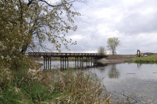 New bridge means link to NY wildlife refuge island  A new bridge provides hunters, hikers, bikers and birders with year-round access to 3,500 acres of protected wilderness in the Montezuma Wildlife Management Area in Savannah, N.Y. The state Department of Environmental Conservation says the elevated, 100-foot-long wooden bridge will carry vehicles across the Seneca River to Howland Island. It replaces a temporary gravel and culvert in the river, which often flooded in the spring and fall, preventing access to the island. The bridge removes the last barrier to kayaks and canoes, opening up a 10-mile float around Howland Island. A parking lot on the island provides access to 300 acres of marshland and 17 miles of gravel service roads in the refuge. The bridge, completed this month, was built with funding from an excise tax on firearms and ammunition.