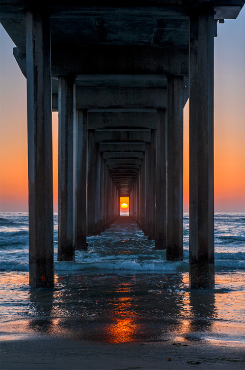 0rient-express:  Pier Sunset | by John Moore.   Light your road