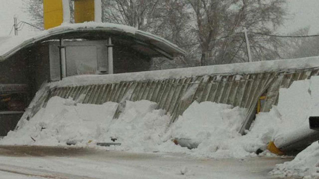 My cousin sent me this picture from Alva, Oklahoma on Monday. The blizzard dumped 20 inches of snow and caused the Sonic Drive-In to collapse. No more soft drink happy hours in Alva for a while it seems.