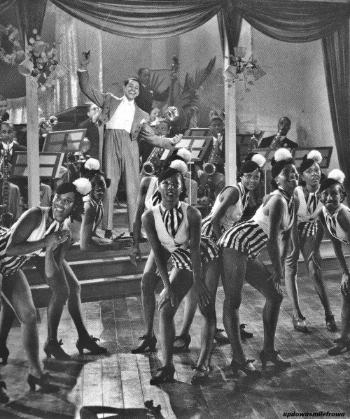updownsmilefrown:  Cab Calloway and his orchestra with the Cotton Club Chorus at the Cotton Club, 1936.