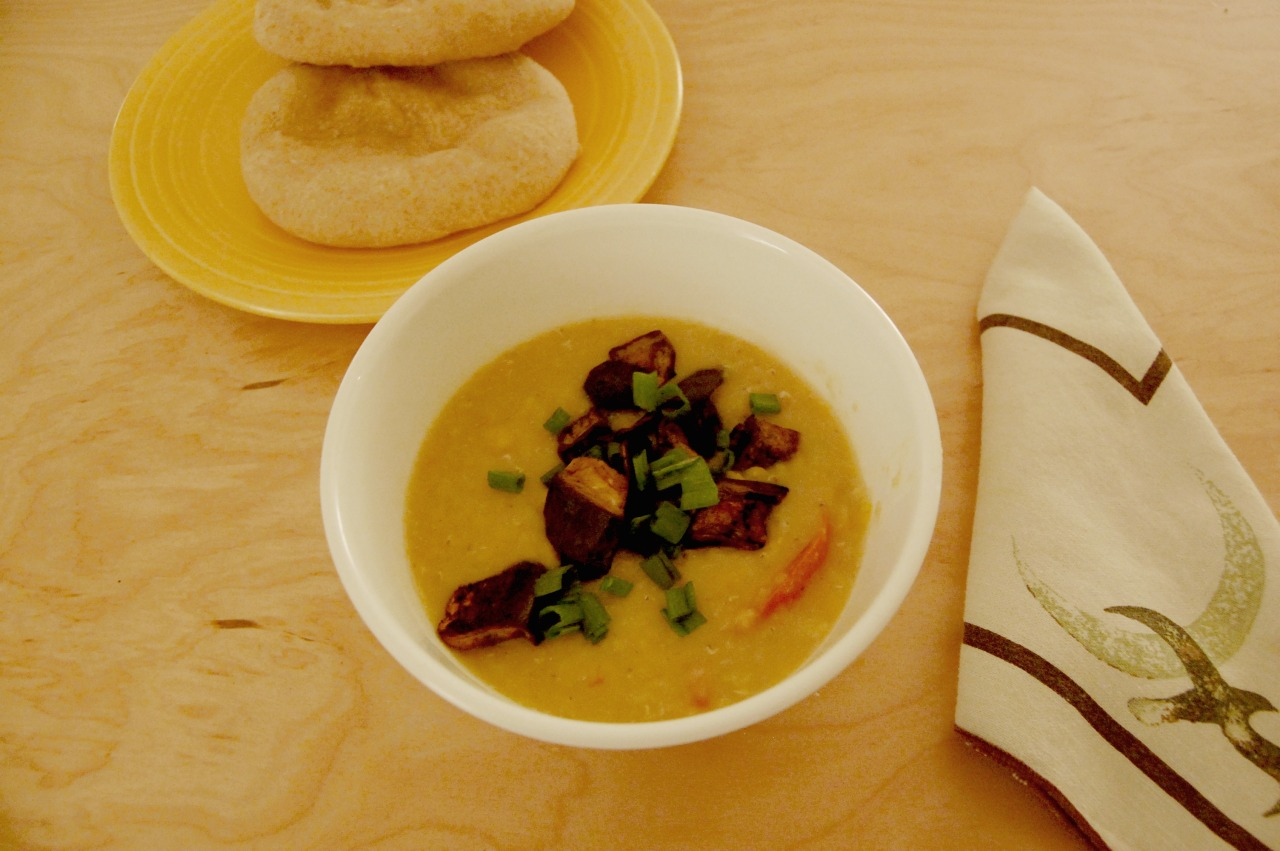 sarahfromthefuture:  Mark Bittman's Simplest Dal with Tomatoes  Plus some roasted eggplant and some homemade pita bread   Spring, schming. Keep those stock tips coming!