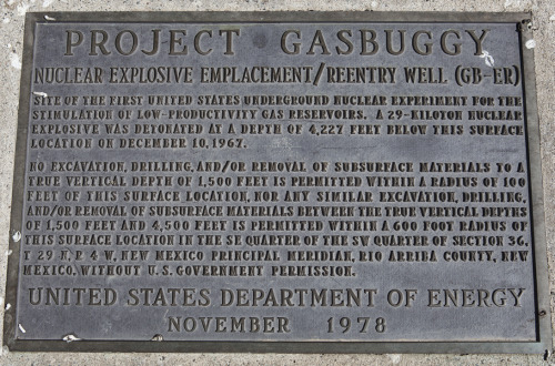 PROJECT GASBUGGY - FARMINGTON, NEW MEXICO Once upon a time in the west, December 1967 to be exact, some men from the Lawrence Radiation Laboratory and some men from the EL Paso Natural Gas company buried a 29-kiloton nuclear bomb (Hiroshima was around 13-kilotons) in the ground just west of Farmington, New Mexico, in the Carson National Forest.  Then they set it off. Project Gasbuggy was the first of three industry-government experiments conducted in the Four Corners area under the Operation Plowshare program to turn swords into plowshares.  The grand idea was to find peaceful uses for nuclear weapons, in this case to stimulate energy production by fracking for natural gas on an epic scale. The bomb used at Gasbuggy was 13 feet long and 17.5 inches in diameter.  It took three days to lower the bomb 4,240 feet underground.  Once there, it was cemented into place in the dense, but natural gas rich Lewis shale formation. The resulting explosion — and 5.10 magnitude earthquake — left a crater on top and an underground glass lined chimney 335 feet high and 160 feet in diameter.  As predicted, the detonation shattered the shale and dramatically increased the amount of gas that was recoverable. It also made the gas so radioactive that it couldn't be used. Somehow feeling that unleashing that much natural underground radiation with a nuclear explosion might turn out differently, the experiment was tried two more times: first with the 40-kiloton Project Rulison near Parachute, Colorado, and finally with Project Rio Blanco's three simultaneous 33-kiloton detonations near Rifle, Colorado. While the public was initially supportive before Gasbuggy, by the time of Rulison in 1969 the tide had changed.  With a new national sense of environmentalism taking root, Operation Plowshare would come to an end after Rio Blanco in 1973. Then they just had to clean it all up. To visit the Project Gasbuggy site, look for mile marker 115 on Highway 64.  Turn onto the Jicarilla Apache reservation road J-10, and follow it for 7.25 miles.  At that point you will enter the Carson National Forest, and the road will turn into Forest Service 357.  Go one more mile and you are at ground zero. Guide Notes:  Plowshare, the Movie  Plowshare background, including a list of planned but not executed tests in such places as Pennsylvania, Mississippi, Australia, Canadian tar sands and Buffalo, Wyoming, among others.  Carson National Forest  * * * At-Large Guide to the West James Orndorf was born in Minnesota, but knew at a very young age that the future lay out west. He is currently photographing and illustrating outside of Durango, Colorado. You can see what he's up to at inlandwest.tumblr.com and roughshelter.com.