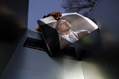 jbarandica:  A woman sells newspapers with a picture of U.S. President Barack Obama on the National Mall for the ceremonial swearing-in on the West front of the U.S. Capitol in Washington January 21, 2013. REUTERS/Eric Thayer (UNITED STATES - Tags: POLITICS TPX IMAGES OF THE DAY)