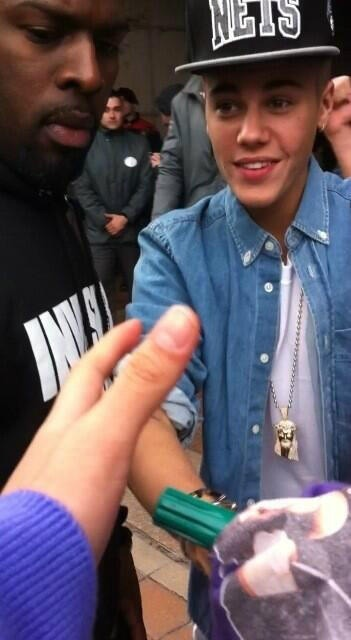Justin greeting fans earlier today in Barcelona
