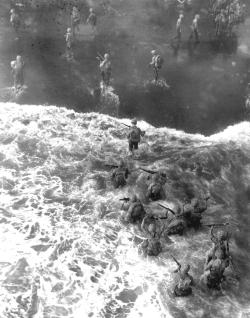 operationbarbarossa:  US Marines of the 1st Marine Division wade ashore from their LST in rough water to take the beach at Cape Gloucester on New Britain, Papua New Guinea - 26 December 1943