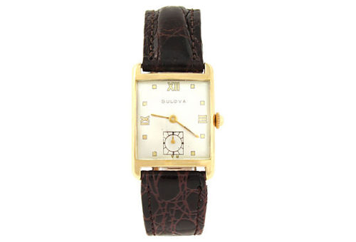 Tank-style 14K yellow gold wristwatch with crocodile-embossed calf leather strap by Bulova. Seventeen-jewel mechanical movement. Includes case. Marked: 14K gold Bulova 5137962. by Ruby + George on One Kings Lane Vintage and Market Finds