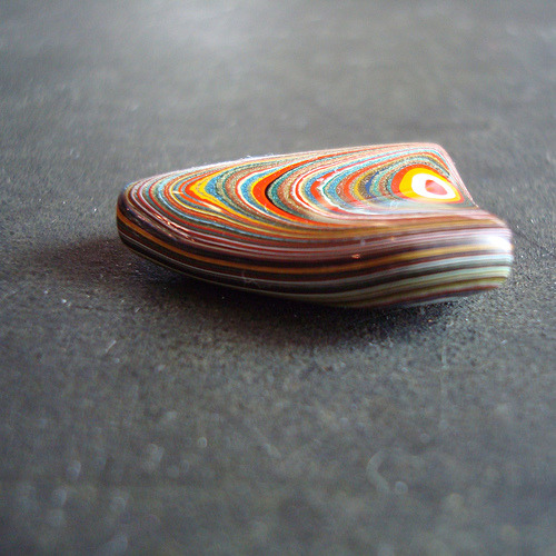 Fordite. Source. Layers of paint from the automotive frames in Ford plants - learn more here.