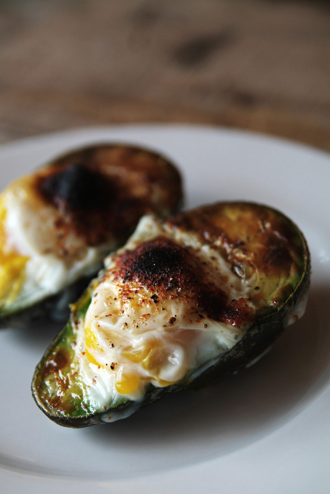 baked avocado and egg: by me This morning for breakfast I tried this recipe. Now, although it looks really delicious in this picture that I took, mainly because I removed it from the shit storm that was left after cooking, I would like to write a little bit about the actual experience of making it. If you refer to the recipe as linked above, it says, scoop out the pit, crack in an egg, and cook. What actually happens is this; Scoop out the pit revealing only a tiny hole in the Avocado, try cracking your egg into it only for almost all of it to run all over the baking sheet, then swear a lot, scoop out almost half of the Avocado in order to get the egg to fit only to find it is still not a big enough space and egg white oozes all over the place. Sprinkle with salt, pepper, and paprika, then bake in an oven until the egg is done to your satisfaction. While this is an interesting recipe and I really liked the idea it was a pain in the arse to actually make. The recipe should have read like this; 1. Get the biggest Avocado you can find, preferably as big as your head. 2. Get the smallest egg you find, preferably a Quail egg, because quite          honestly, that's all that will really fit. 3. Continue recipe as instructed.