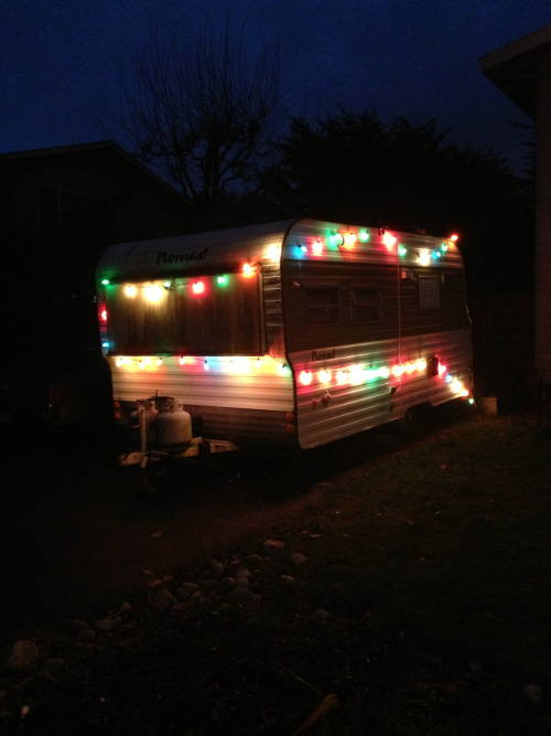 Our neighbor's rusty Nomad decked out for the holidays.