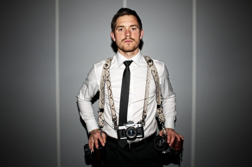 Python Money Maker Multi-Camera Harness This Python Money Maker is about to run wild on you. Genuine first grade natural Python with stark black and white contrasting marks mated to the highest grade Bridle leather, anchored metal d-rings, and impeccable design make this an essential tool for the modern day pro. Secure your cameras and important gear where it's most accessible and comfortable—right on you.  Quick on the draw? So is the Money Maker. The ingenious Speed Clutch allows you to slide your camera up and down the harness with the greatest of ease. And for those days you need to pack extra heat, simply attach 2 Hold Fast Camera Leashes to carry a third camera (comes included) OR even the Luggage Tag Wallet for quick acces to your life in smalls. Once you pair the Money Maker with the Photo Belt, Camera Leashes and Wallets you could have the most versatile system ever made. The Python Money Maker is built to last a lifetime with four rows of stitching running the entire length along with hand painted edges.   MORE INFO HERE
