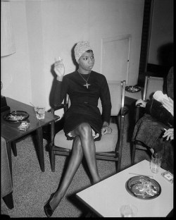 "vintageblackglamour:  Nina Simone would have turned 80 years old today. Born Eunice Kathleen Waymon in Tryon, North Carolina, she changed her name to Nina Simone (""Nina"" meaning ""little one"" and ""Simone"" after the actress Simone Signoret) after she began singing in bars early in her career, something her Methodist minister mother none too subtly referred to as ""working in the fires of hell."" This photo I am sharing today is my favorite of Ms. Simone, a stunning shot by Pittsburgh photography icon Charles ""Teenie"" Harris, circa 1965."