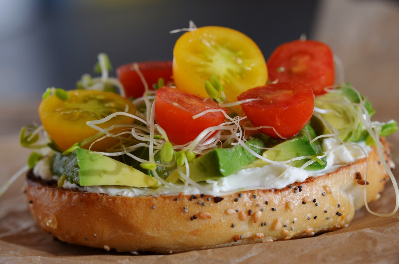 This was lunch today Half a toasted bagel with cream cheese, sliced avocado, sprouts, and cherry tomatoes from