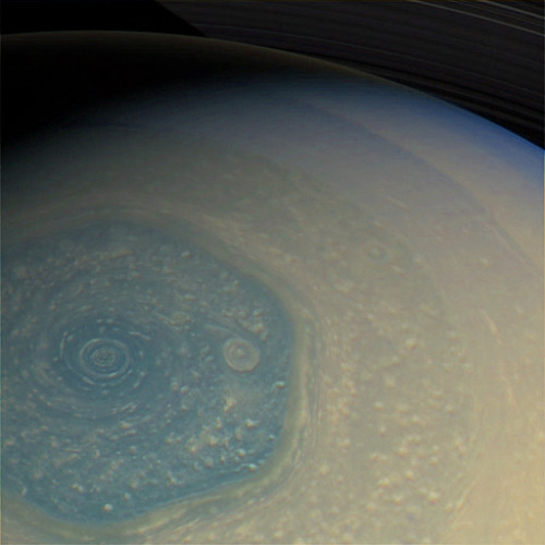 this is a view of saturn's north polar region, taken by cassini's imaging science subsystem (ISS) on february 26, 2013. you can see the rings in the top of this image as well as its mysterious hexagon.