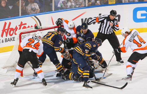 The Sabres battle the Flyers in front of the net.