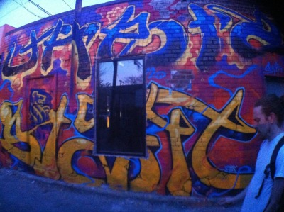 Randomly snapped this photo in a graffiti alley off Queen St. It looks like he is blowing smoke out the way his hand and mouth line up with the graff.