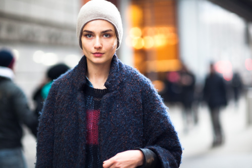 Street Beauty: Andreea Diaconu @IMGModels between castings and fittings in Midtown. Wearing Isabel Marant and J.Crew. It's a bit hard to shoot street style in the winter - people are just trying not to freeze and bundled in scarves but Andreea still glows (and her hair is covered up!) She has a solo editorial in the current Vogue Paris.