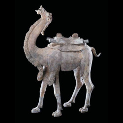 "T'ang Large Terracotta Sculpture of a Camel  Origin: ChinaCirca: 618 AD to 906 AD  Dimensions: 35.5"" (90.2cm) high"