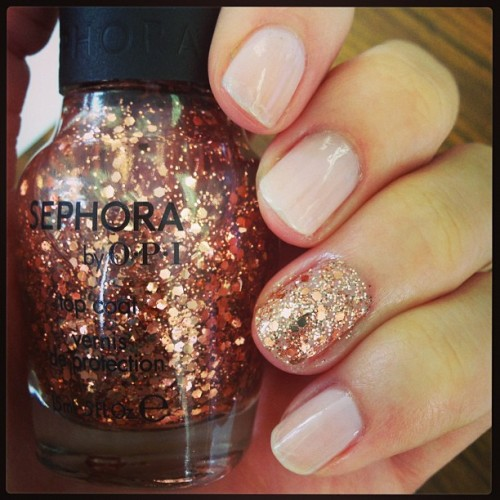 Current nails: sheer nude and an accent nail with gold craft glitter and rose gold hex on top. I wuv it. #notd #accentnail