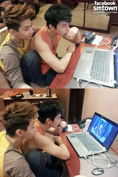 Henry and Donghae are monitoring their performance. [from FACEBOOK SUPER JUNIOR STAFF]