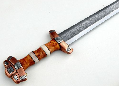 art-of-swords:  Handmade Swords - Viikinkimiekka XI Maker: Jarkko Niskanen Medium: steel, iron, coper, silver, willow wood, moose antler, wool, linen, brass Measurements: overall length 87.5cm; blade length 70.5cm; weight 1165g The Viking sword has a pattern welded blade with edges of 0.6% carbon steel. The guard and pommel are made of iron and covered with copper and silver inlays. Decorative patterns are carved into silver. The grip is made of salix caprea (willow wood) and moose antler, while the scabbard is also made from willow wood filled with linen/wool. The fittings are made of brass with the strap bridge and decorative panels made of moose antler.  Source: Copyright © 2014 Jarkko Niskanen