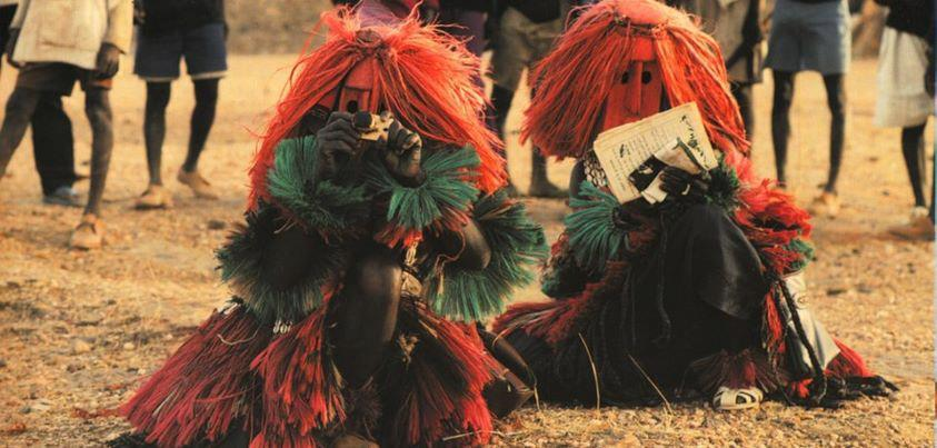 thefemaletyrant:  akilivumbi:  Dogon masked dancers mimicking Western photographers and ethnologist   Michel Renaudeau  This is excellent!