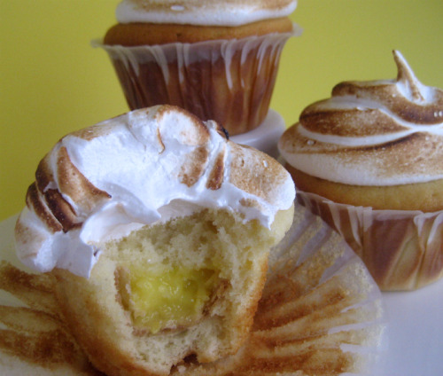 Finally! Lemon meringue pie in a cupcake! The cream cheese cupcake is stuffed with a mini lemon pie and the whole thing is topped with a sweet cloud of toasted meringue. Magic. Here's the recipe.