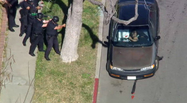 Video: DUI suspect huffs balloons in bizarre standoff with police