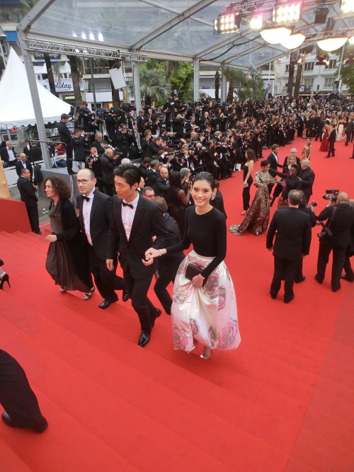 "snejspo:  thesocietynyc:  Our Ming Xi dazzles the 2013 Cannes Film Festival red carpet for the premiere of ""Jeune & Jolie,"" escorted by Chinese actor Shawn Dou."