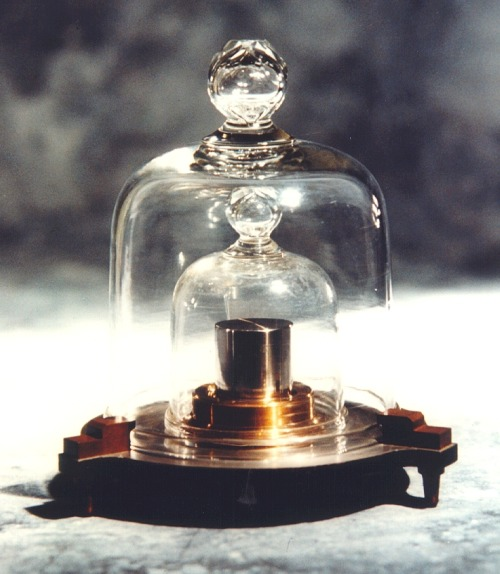 "jtotheizzoe:  The Not-So-Perfect Kilogram and Why the Metric System Might Be Screwed The official kilogram standard, a precise chunk of platinum and iridium named ""Le Grand K"", has been losing weight. Housed at the International Bureau of Weights and Measures, this weight standard (or really, a few replicas of it, since it's best not to handle this one), is used to calculate the basis of other standards like the joule, which happens to be pretty important when it comes to technology. This could mean slight, but significant problems for key standards in a world where technology performance is measured in atoms and femtosomethings. Where is the weight going? The carefully handled replicas could be gaining weight, making Le Grand K seem lighter, or it could actually be losing gas from inside its seemingly sold metal interior. Yep, even metal does that. Scientists around the world are trying to come up with a different way to calculate a kilogram than a hunk of metal, but for now it's all we've got. Talk about a weight problem. (via Mental Floss)"
