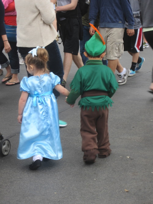Peter Pan and Wendy in Disneyland.  THEY'RE HOLDING HANDS. Oh my gahhhhh I can't even. So damn cute.