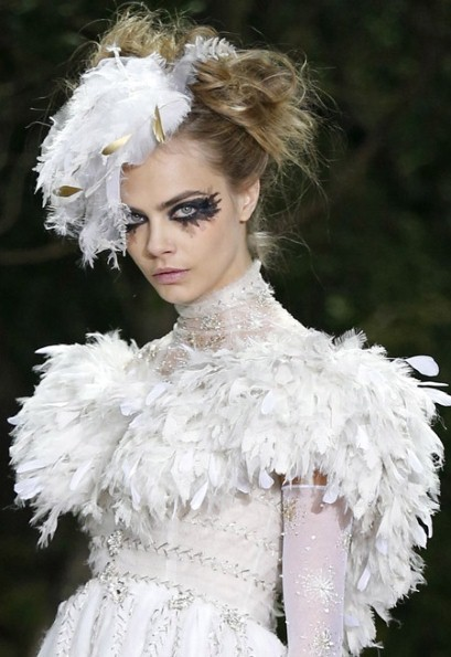 Spring Hair Inspiration from Paris Haute Couture, Chanel's New Polish, and More Paris Haute Couture shows are, yet again, bringing beauty to a whole new level of extraordinary. Case in point, Chanel's feathered updo in the photo above.  [Bellasugar] One of the best makeup tricks we've ever seen: here's how to use mascara as a liquid liner. [Refinery29] Penthouse for sale! Kelly Ripa has listed her New York City apartment for $24.5 million. Whoa. [E! Online] This new water-permeable nail polish formula is giving Muslim women, who traditionally can't wear lacquer during their daily prayers, a chance to wear the trend. [The Cut] Give your outfit a little edge! Try wearing socks with your heels. [Glo] Chanel's latest polish color—Emprise, a pastel coral—was a hit at the brand's Paris Haute Couture show. Here's where you can buy it right now. [SheFinds]  Add some sparkle to your eye with glitter eyeliner. [Beauty High] (Photo: Reuters)  —Charisse  Get the perfectly winged cat-eye with these liquid liner troubleshooting tips.