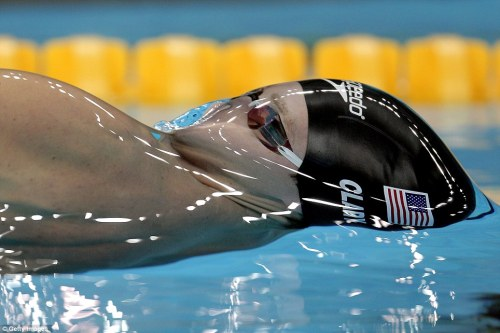 Surface tension creates a glassy, smooth layer of water over U.S. swimmer Tyler Clary the instant before he surfaces as he competes in the backstroke. Surface tension arises from intermolecular forces between water molecules. In the bulk of the liquid, any given water molecule is being pulled on in every direction by the surrounding molecules, which results in zero net force. At the surface, however, molecules only experience forces from those to the side and below them. As a result, these molecules are pulled inwards, forcing the liquid to take on a form with minimal area. (Photo credit: Getty Images; submitted by drhawkins)