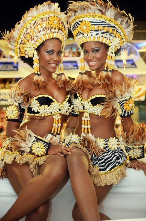 africanfashion:  Angolan girls celebrating Carnaval! - Leila Lopes is on the right and stunning as always.