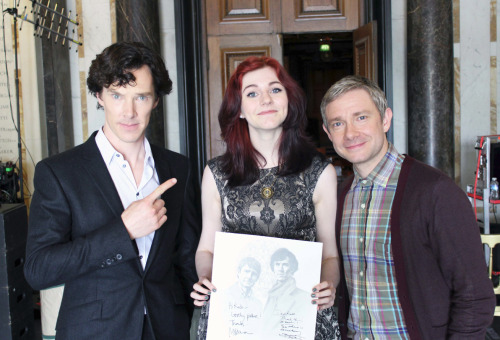"cumberbuddy:  watsonsdick:  wryer:  oday was the best day of my life. I can't believe I was lucky enough to meet two of my favourite actors in the world, I can't express how grateful I am. As I took the train to London this morning I was more nervous than I'd ever been, I thought that as soon as I saw Benedict I would surely faint or burst into tears… and I expected to be really intimidated by Martin Freeman because he's such a big star now! But as soon as Martin came over and shook my hand I just felt happy, he was so lovely and his smile warmed the cockles of my heart. I must admit that when Benedict came over and stood next to me I felt very shaky and as though my heart was ready to burst out of my chest, but as soon as he asked my name and spoke to me it was simply wonderful. Martin was a real charmer and Benedict was so funny and unlike anyone I've ever seen before. They were both so incredibly kind about my artwork, it was so bizarre having two such talented people say that something I do is ""amazing"", when I look up to them so much. As they took the drawings out of the envelopes and gasped and praised me I felt like my heart was going to explode then and there. They said it was the best fan art they've ever received. It made me want to break down. To have Benedict Cumberbatch say I'm ""talented"" is something which I just can't handle or comprehend. I just couldn't get my head round it. I feel so overwhelmed right now, the whole experience was so very surreal. I feel so incredibly happy, it was so amazing. I feel kind of dumbstruck right now, I can't believe it happened to me. This was the drawing I gave to Benedict as a gift, and this one for Martin. I'm keeping the signed one for myself, forever.Also I thought I'd just point out the LENGTH OF BENEDICT'S FINGER I MEAN WHAT IS THAT  awesome! congrats! :D  You look thrilled! Nice one and AMAZING ART!! His finger is just obscene.  They all look great: Martin, Benedict and Kate."