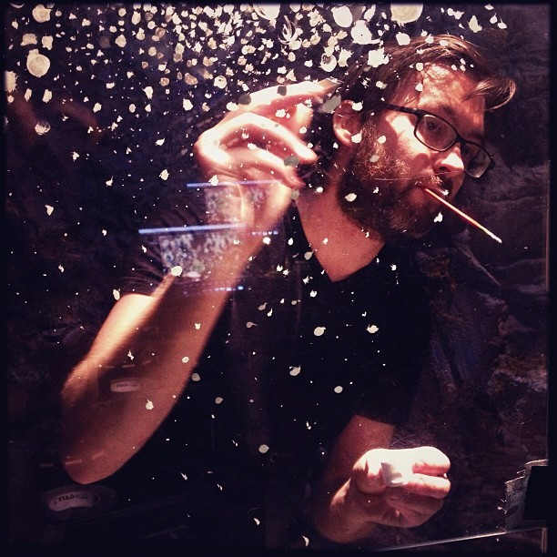 photo by Mike Ambs painting in hundreds of bubbles on two large sheets of glass for tomorrow's splash-down scene :) #blank