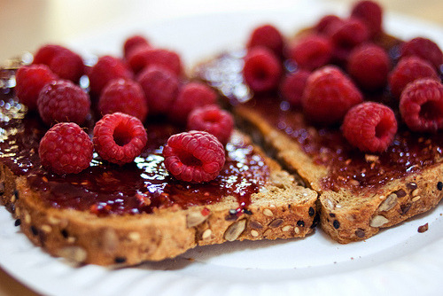 Whole Grain Toast w. Jam topped with Raspberries