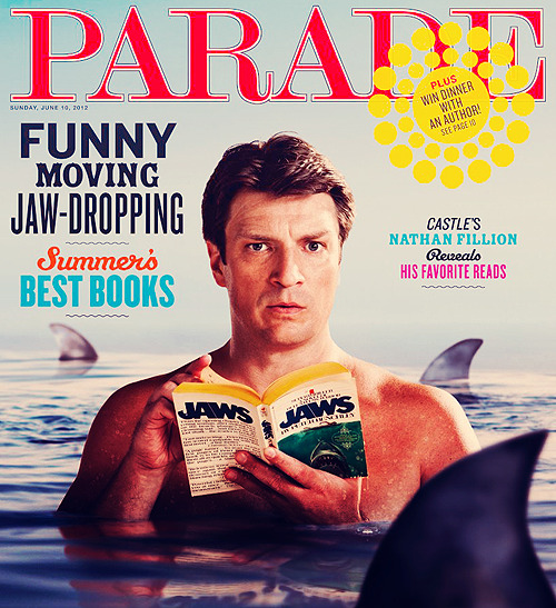 awesomepeoplereading:  Nathan Fillion reads, is circled by sharks.