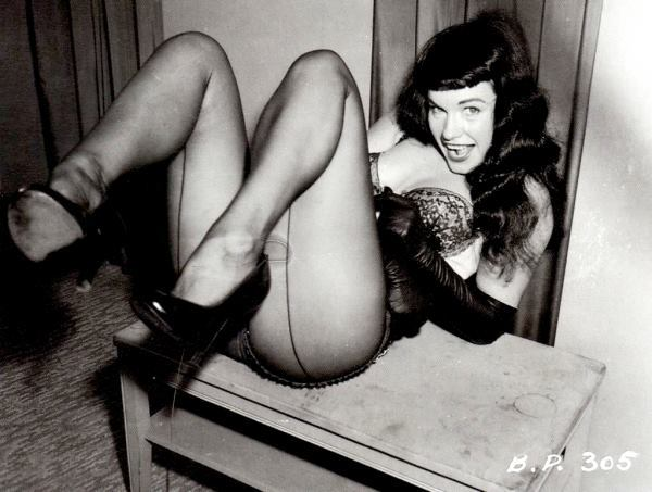 "joeyx:  On this day in 1923: Bettie Page was born in Nashville, Tennessee. Today's hairstyle: Bettie's bangs Today's screening: LEOPARD BIKINI BOUND, STRIPORAMA, TEASERAMA, and VARIETEASE Today's quote: ""I was never the girl next door"" Today's ill-advised tattoo cavalcade!:http://tinyurl.com/7eyc82e,http://tinyurl.com/7fke3kb,http://tinyurl.com/7mv8b74,http://tinyurl.com/6ty8b3x,http://tinyurl.com/6lkz94c Happy 90th birthday to Playboy's Miss January 1955 and the Queen of the Pin-Ups!"