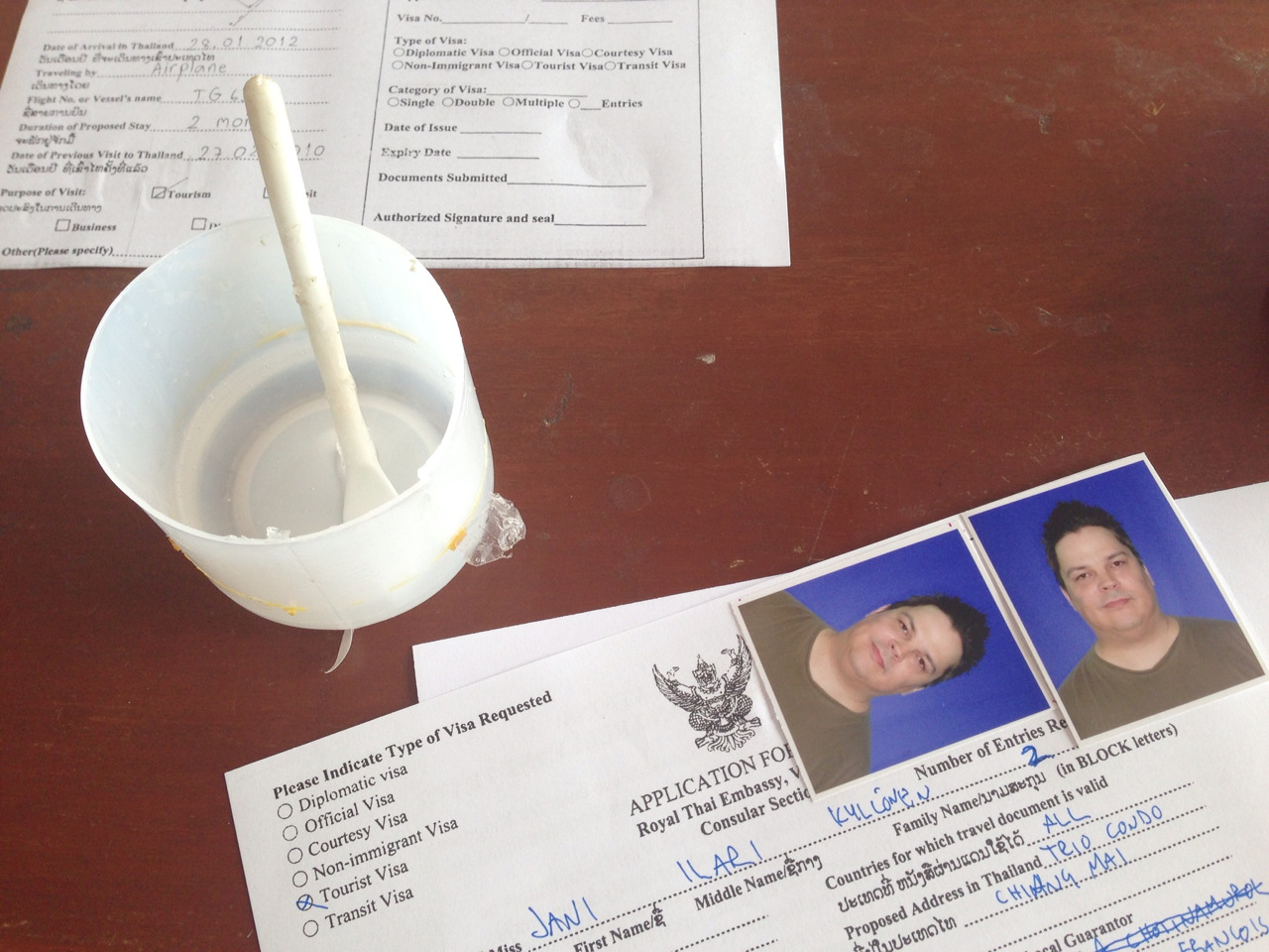 Visa running in Laos. I love the little pots of glue they provide.