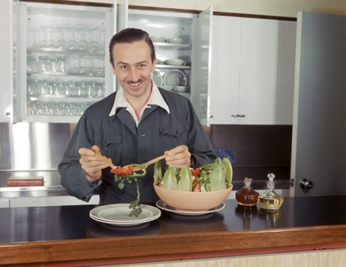 Walt Disney makes a salad in the kitchen adjacent to his office at the newly opened Disney Studios in Burbank, California - c. 1940(s)