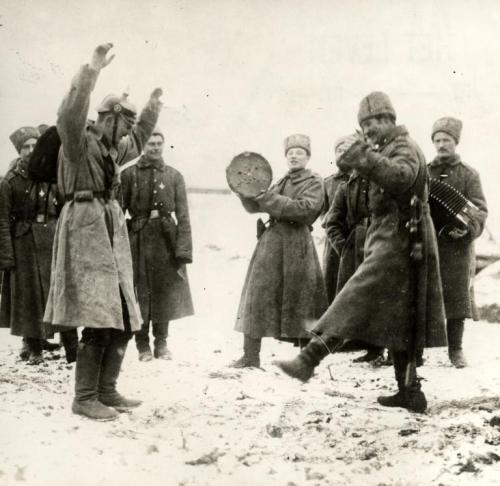 "ryanshistoryblog:  ""The Russians teaching the German prisoners of war the cossack dance. The Eastern front, Russia, 1915."" From: The Dutch National Archives"