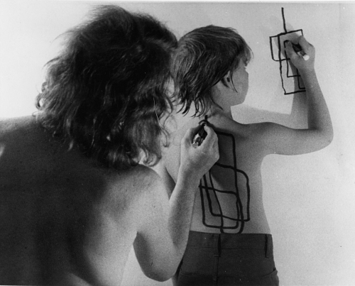 "razorshapes:  Dennis Oppenheim - Two Stage Transfer Drawing (1971)  ""As I run a marker along Eric's s back he attempts to duplicate the movement on the wall. My activity stimulates a kinetic response from his sensory system. I am, therefore, Drawing Through Him"""