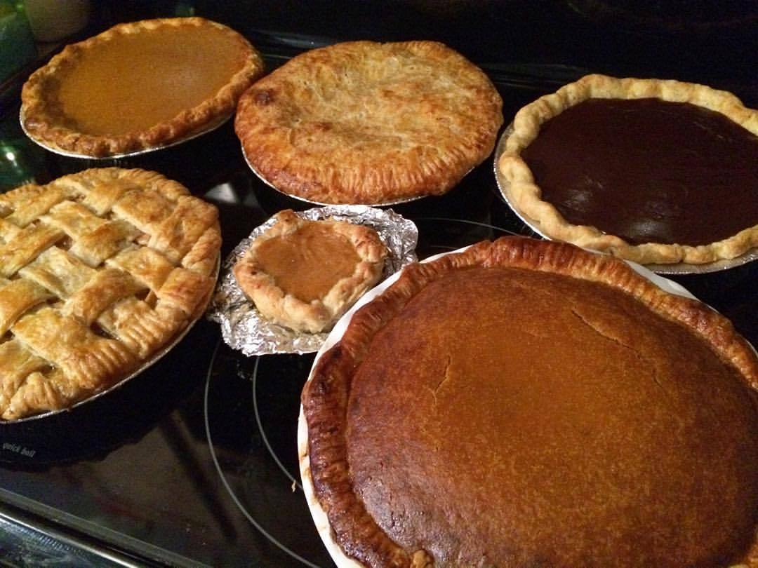 The spoils of today's baking marathon: cherry, apple, chocolate, and 2.5 pumpkin pies! #thanksgiving #pie