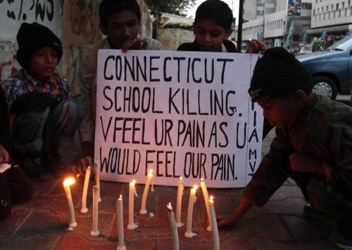 wordsandbirdcages:  Pakistani children light candles to pay tribute to Sandy Hook Elementary School shooting victims in southern Pakistani port city of Karachi on Dec. 15, 2012.