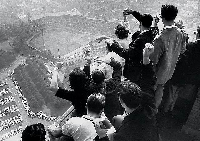 University of Pittsburgh students cheer as they look down on Forbes Field from the top of their campus's Cathedral of Learning during the 1960 World Series between the Pirates and Yankees. In Game 7, Bill Mazeroski hit the first walk-off home run in World Series history, a shot over the left-field fence that gave the Pirates a 10-9 win. (George Silk/Time Life Pictures) GALLERY: 100 Best Sports Photos of All Time